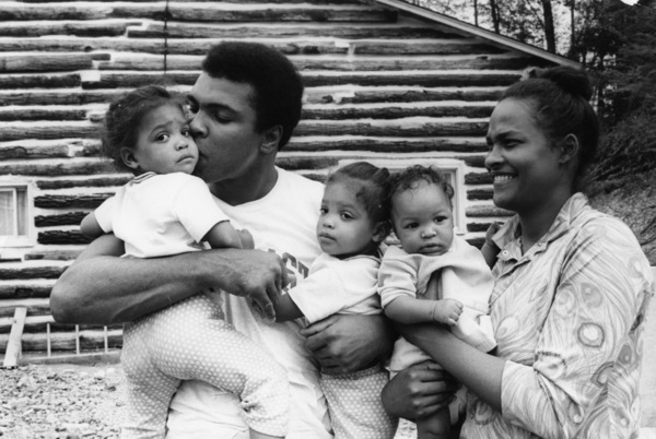 Muhammad Ali stands with his wife Belinda Boyd and children outside his training camp in Deer Lake, Pennsylvaniacirca 1971© 1978 Gunther - Image 7683_0479