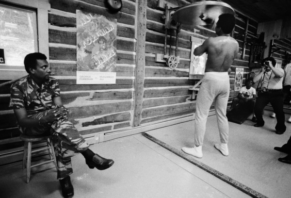 Black Power activist Stokely Carmichael watches Muhammad Ali from a stool in the corner1974© 1978 Peter Angelo Simon - Image 7683_0605