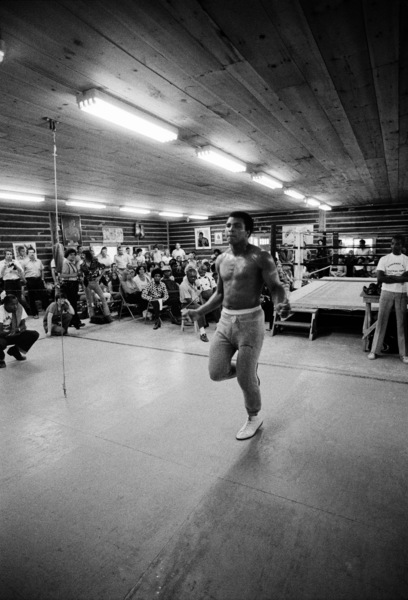 Lightweight world boxing champion Ike Williams (immediately to left of Muhammad Ali on white stool); boxer Bobby McQuillam (to right of Ali leaning against table)1974© 1978 Peter Angelo Simon - Image 7683_0607