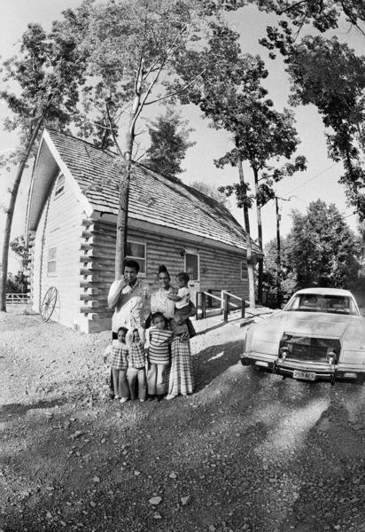 "Muhammad Ali with his family: Rashidah Ali, Jamillah Ali, Maryum ""May May"" Ali (hands over her face), Belinda Ali, and Muhammad Ali, Jr.1974© 1978 Peter Angelo Simon - Image 7683_0623"