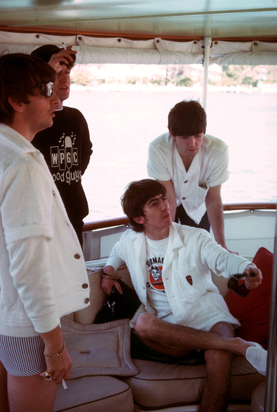 The Beatles (Ringo Starr, John Lennon, George Harrison, Paul McCartney) on board a boat.1964 © 1978 Gunther / MPTV - Image 7685_0036