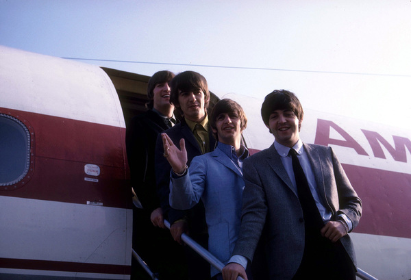 The Beatles, (John Lennon, George Harrison, Ringo Starr, Paul McCartney) getting off the plane.1964 © 1978 Gunther / MPTV - Image 7685_0042