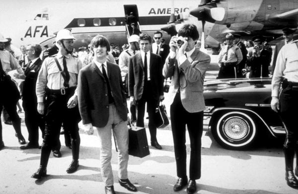The Beatles Ringo Starr, Derek Taylor (Press Officer), & Paul McCartney shooting with a camera,Toronto, Canada, September 7, 1964 © 1978 Gunther / MPTV - Image 7685_0120