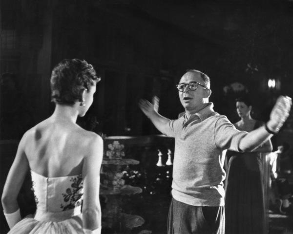 "Audrey Hepburn with director Billy Wilder on the set of ""Sabrina"" 1953© 2000 Mark Shaw - Image 8124_0028"