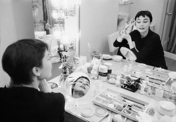 "Audrey Hepburn is her dressing room during the filming of ""Sabrina""1953© 2000 Mark Shaw - Image 8124_0090"