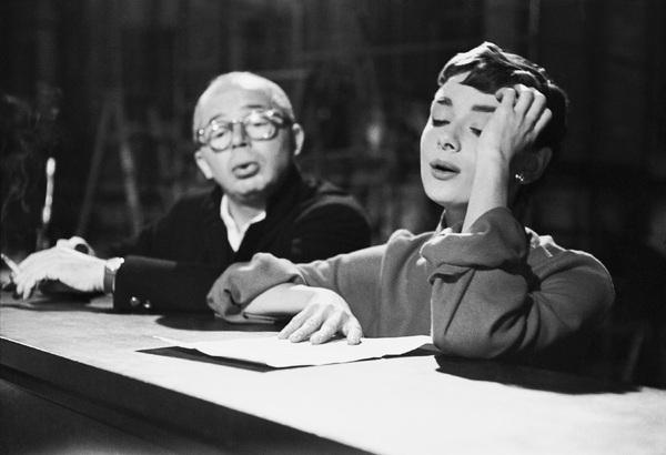 "Director Billy Wilder and Audrey Hepburn behind the scenes of ""Sabrina""1953© 2000 Mark Shaw - Image 8124_0101"