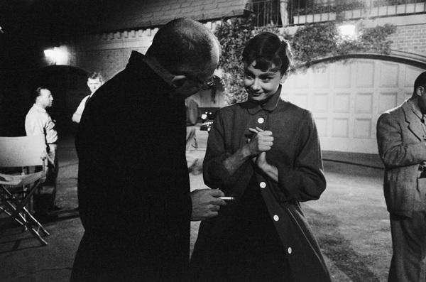 "Audrey Hepburn on the set of ""Sabrina"" with director Billy Wilder1953© 2000 Mark Shaw - Image 8124_0102"