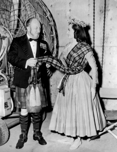 "Commander K.D. Iain Murray, technical advisor, and Cyd Charisse on the set of ""Brigadoon""1954 MGM** I.V. - Image 8705_0014"
