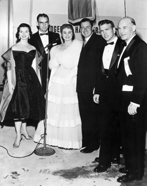 "Miss Oklahoma, Clarence Burch (executive assistant to the Governor of Oklahoma), Shirley Jones, Will Rogers Jr., Oklahoma State Senator George Nye and Dick Dickson (United Artists Theatre Circuit, Inc., executive) at the Hollywood premiere of ""Oklahoma!"" at the Egyptian Theatre 11-17-1955** B.D.M. - Image 9577_0004"