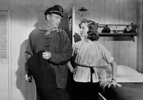 """Blood Alley""John Wayne and Lauren Bacall. © 1955 Warner Bros. - Image 9961_0001"